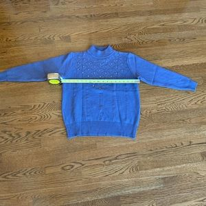 Brand new blue sweater w/ rhinestone detail.
